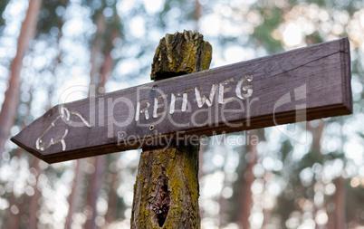 german waymarker reitweg on a stock of a tree