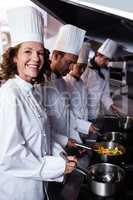 Chefs preparing food in kitchen