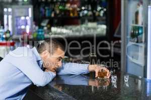 Depressed man having alcohol