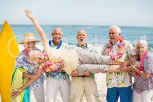 Seniors carrying senior woman