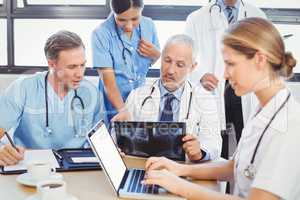 Medical team examining a x report