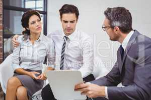 Serious businessman discussing with client