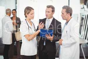 Medical team discussing the report on clipboard