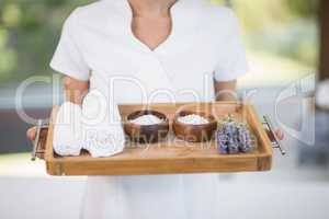 Masseur holding tray with spa therapy products