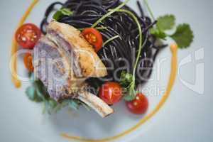 Squid ink spaghetti dish with basil