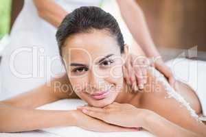 Beautiful young woman receiving spa treatment