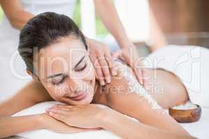 Beautiful young woman enjoying spa treatment