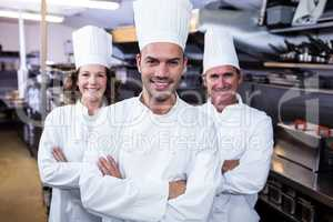 Team of chefs standing with arms crossed