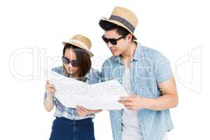 Young couple using map for direction