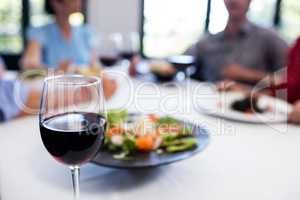 Glass of red wine on the restaurant table