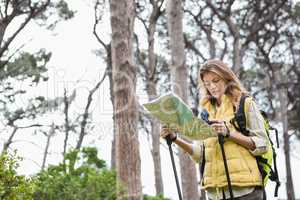Woman with map and compass