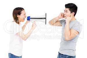 Angry woman shouting at young man on horn loudspeaker