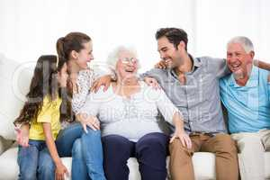 Smiling family with grandparents discussing