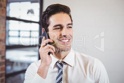 Smart businessman talking on mobile phone