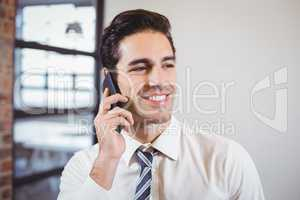 Smart businessman talking on mobile phone