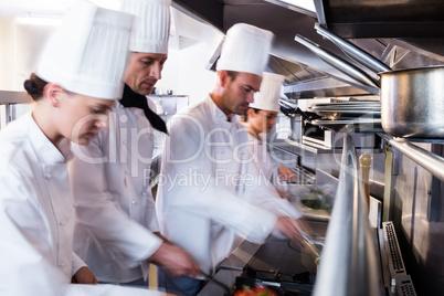 Chefs preparing food in the kitchen