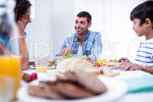 Family sitting at breakfast table