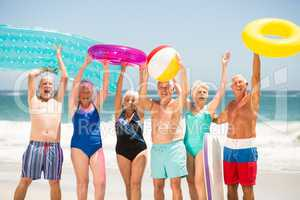 Seniors standing in a row at the beach