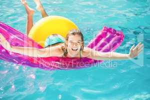 Happy woman floating on air bed