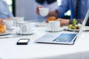 Laptop and mobile phone on the restaurant table