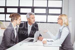 Business people discussing with client