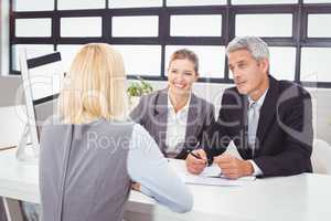 Bbusiness people discussing with client