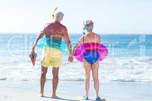 Senior couple with beach equipment