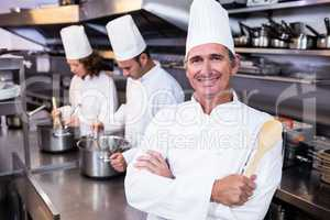 Portrait of smiling chef in commercial kitchen