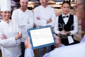 Restaurant manager briefing to his kitchen staff