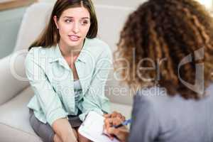 Woman discussing problems with female psychologist