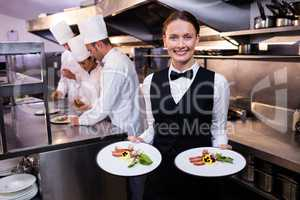 Waitress showing dishes to the camera