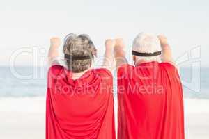 Seniors wearing superman costume