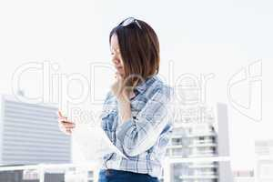 Young woman looking at map for direction