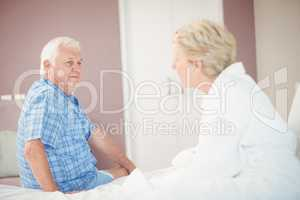 Angry senior couple in bedroom