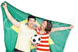 Couple holding brazil flag