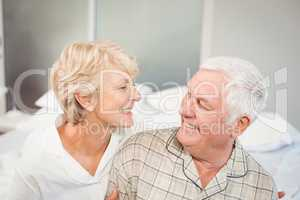High angle view of happy senior couple in nightwear
