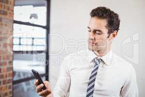 Smart businessman using smartphone