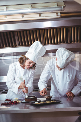 Chefs decorating a cake