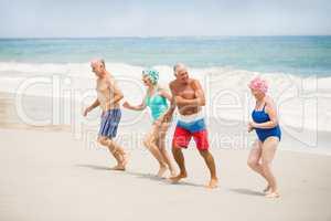 Seniors running at the beach