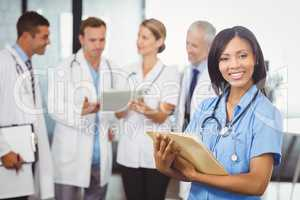Portrait of female doctor holding medical report