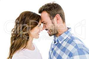 Happy young couple rubbing nose