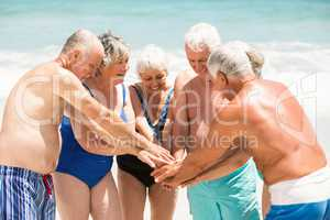 Seniors standing in a circle at the beach