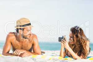 Girlfriend taking picture of boyfriend