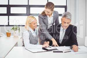 Business people explaining client with documents