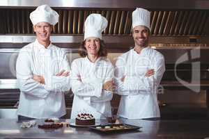 Chefs happy and proud to present the cake they just made