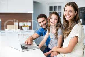 Portrait of family with laptop