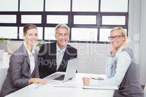Portrait of business people with client