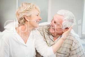 Happy senior woman romancing with husband