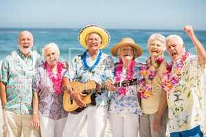 Seniors singing and playing guitar