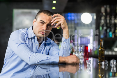 Depressed man drinking alcohol